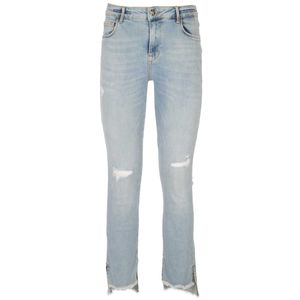 Bodoquena jeans with destroyed effect and raw hem at the bottom