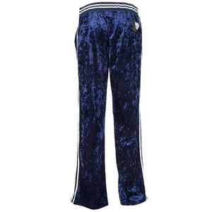 Blue velvet trousers with floral pattern