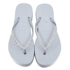 Flip-flops with glitter and oversized sole