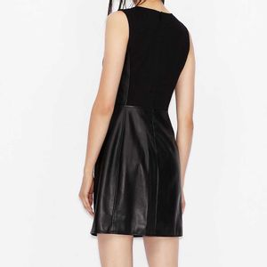 Short dress in black faux leather with zip