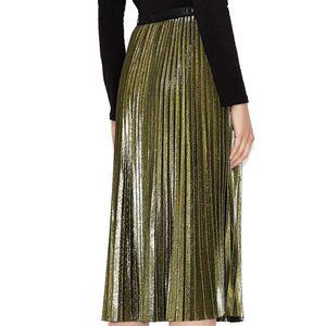Golden pleated skirt with branded belt