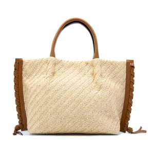 Handbag in raffia and leather