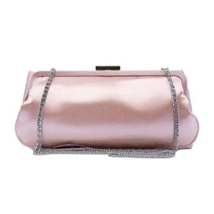 Pink clutch bag with bow