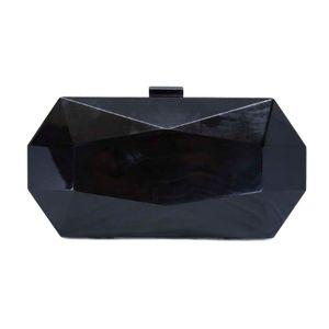 Unique rigid clutch bag