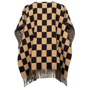 Checked poncho in wool and cotton