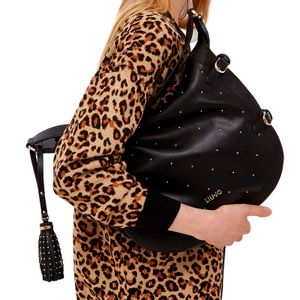 Shoulder bag with studs and tassel
