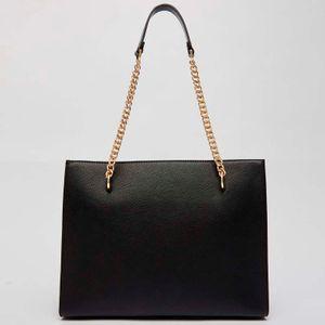 Shoulder bag in drummed eco-leather